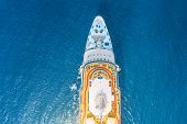 Close Up Aerial Top View Nose Of The Cruise Ship In The Turquoise Sea. Concept Of Summer Sea Cruise  poster