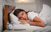 Insomnia. Unhappy Young Woman Suffering From Anxiety And Sleeplessness Lying In Bed At Home At Night poster