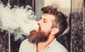 Smoking Electronic Cigarette. Stress Relief Concept. Smoking Device. Man Long Beard Relaxed With Smo poster
