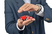 Businessman Holding A Toy Car On His Hand