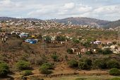 Housing And Huts Scattered Informally Over Hilly Area In Rural South Africa poster