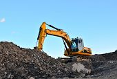 Large Tracked Excavator Works In A Gravel Pit. Loading Of Stone And Rubble For Its Processing At A C poster