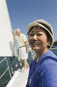 image of early 60s  - Smiling Woman and Husband on Sailboat - JPG
