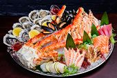 Seafood Platter. Seafood On A Large Plate. Assorted Seafood From Mussels, Oysters, Crab, Shrimp poster