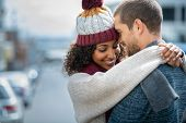 Romantic man and woman embracing outdoor in autumn. Happy boyfriend and smiling african girlfriend h poster