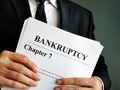 Bankruptcy Chapter 7 Stack Of Documents In The Hands. poster