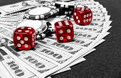 Stack Of Poker Chips With Dice Rolls On A Dollar Bills, Money. Poker Table At The Casino. Poker Game poster