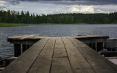 Picturesque View From A Wooden Pier On A Forest Lake In Windy Cloudy Weather. Atmospheric Landscape  poster