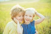 Sweet Childhood. Happy Kid On Summer Field. Childcare. Happy Children Girl And Boy Hug On Meadow In  poster