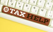 Handwriting Text Tax Help. Concept Meaning Assistance From The Compulsory Contribution To The State  poster