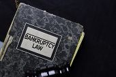 Bankruptcy Law Book And Gavel Isolated On Office Desk. Law Concept poster