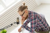 Radio Host Concept - Side View Of Handsome Man Working As Radio Host At Radio Station poster