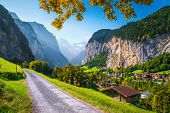 Admirable Alpine Landscape With Mountains, Valleys And Waterfalls. Majestic Lauterbrunnen Touristic  poster