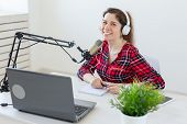 Radio Host Concept - Woman Working As Radio Host Sitting In Front Of Microphone Over White Backgroun poster