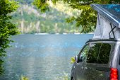 Lake Camping In The Van Rooftop Tent. Modern Camper Van In The Scenic Mountain Location. poster