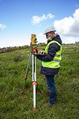image of cartographer  - Engineer with a theodolite for measuring topographic - JPG