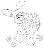 stock photo of cony  - Funny rabbit friendly smiling and carrying a colorfully painted Easter egg - JPG