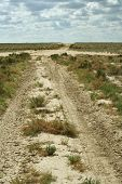 stock photo of groundwater  - Groundwater road in the desert steppe noon - JPG