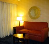 stock photo of futon  - Sofa Coffee Table Mirror and Soft Light Lamp - JPG