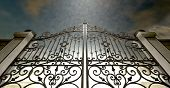 pic of entryway  - A set of closed ornate gates to heaven under an ethereal light and cloudy afterlife - JPG