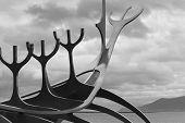 image of metal sculpture  - Sun Craft Metallic Sculpture against cloudy sky black and white - JPG