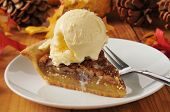 pic of pecan  - a slice of pecan pie with vanilla ice cream on a colorful holiday table - JPG