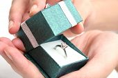 image of marriage proposal  - woman opening ring box - JPG