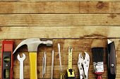 stock photo of tool  - Assortment of tools on wood - JPG