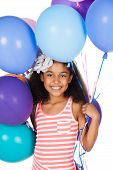 picture of helium  - Adorable cute african child with afro hair wearing a white and pink striped dress - JPG