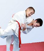 Two boys with white and red belt perform throw  judo