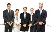 image of slavery  - Group of business people tied with rope and their mouths are taped  - JPG