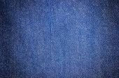 stock photo of denim jeans  - close up dark blue denim jean texture background - JPG