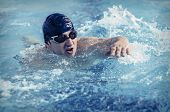foto of swim meet  - Professional male swimmer swimming in the pool - JPG