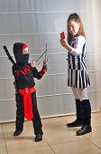 Purim (halloween): Siblings Dressed Up As Soccer Referee And Ninja