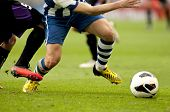 stock photo of leggings  - Legs of two soccer players vie on a match - JPG