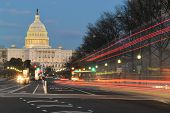 The U.S. Capitol building night view from from Pennsylvania Avenue with car lights trails - Washingt