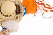 pair of orange sandals, hat and  seashells  frame