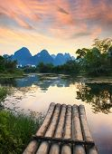 picture of raft  - Bamboo rafts in idyllic li river scenery - JPG