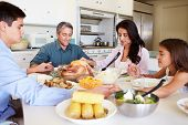 stock photo of 13 year old  - Family Sitting Around Table Saying Prayer Before Eating Meal - JPG