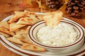 foto of pita  - A plate of toasted pita bread crackers with a cream cheese dip - JPG