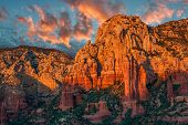 pic of cumulus-clouds  - Sunset creates a pleasing glow on a remote canyon and mountain near Sedona Arizona - JPG