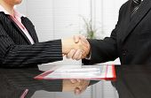 stock photo of lawyer  - Lawyer and client are handshaking after successful meeting - JPG
