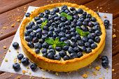 picture of tarts  - Blueberry Tart on vintage brown wooden background - JPG