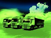foto of neon green  - Three trucks with trailers parked on field in green neon light - JPG