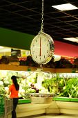 stock photo of grocery store  - Grocery weight scale at a grocery store - JPG