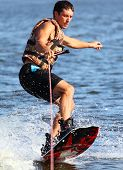 picture of watersports  - Athlete to enjoy riding on a wakeboard riding on the river