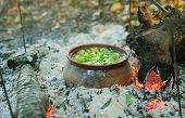 stock photo of pot roast  - Roast cooked in a clay pot over charcoal fire - JPG
