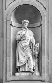 stock photo of alighieri  - Statue of Dante Alighieri in the niches of the Uffizi Gallery colonnade Florence - JPG