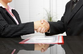 pic of handshake  - Lawyer and client are handshaking after successful meeting - JPG