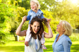 image of grandmother  - Portrait of a happy mother with child and grandmother having fun outdoors - JPG